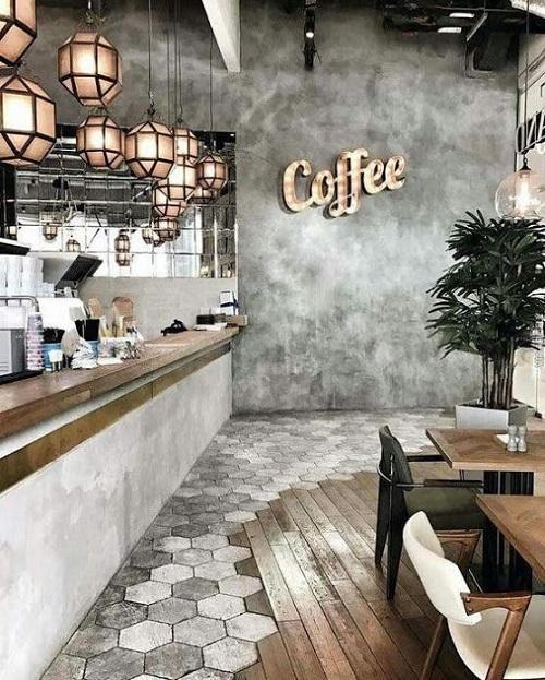 Gạch lục giác màu xám trắng chỉ lát ở một hóc nhất định cho quán cà phê