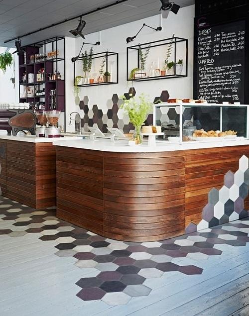Gạch lục giác màu xám cho quán cà phê mang phong cách hiện đại với tông màu sáng