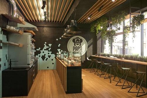 Gạch thẻ trắng hình lục giác kết hợp với màu nâu giúp không gian quán cafe thêm hiện đại, ấn tượng