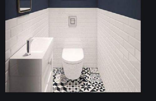 Gạch thẻ màu trắng đem tới không gian hiện đại cho phòng vệ sinh