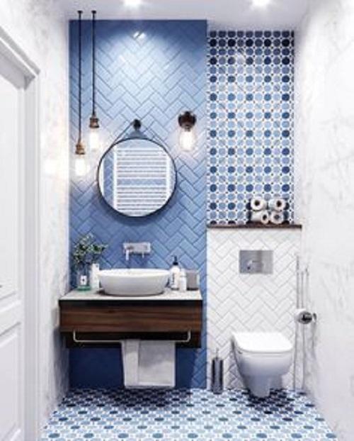 Gạch thẻ màu xanh ốp tường phòng vệ sinh đem đến không gian thêm ấn tượng.